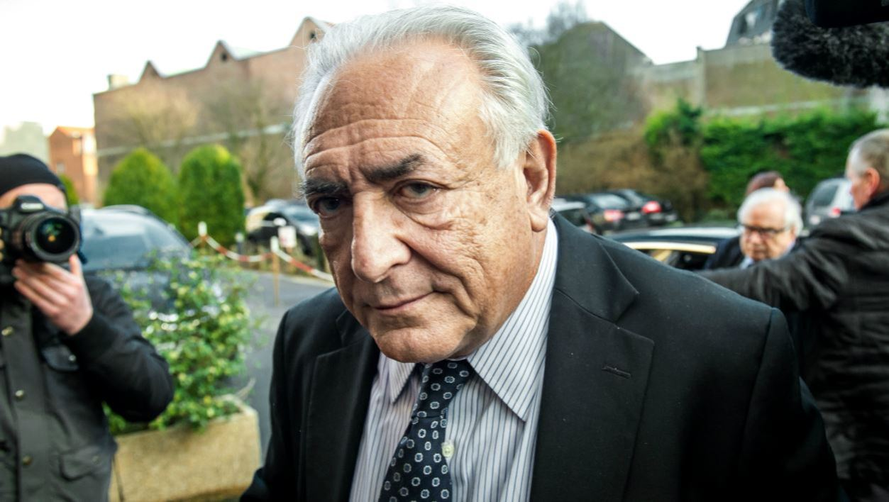 Former IMF chief Dominique Strauss-Kahn arrives to his hotel in Lille, northern France, on February 17, 2015. A French prosecutor called for Dominique Strauss-Kahn to be acquitted of pimping charges in a trial which has seen lurid details of the former IMF chief's sex life exposed in court.
