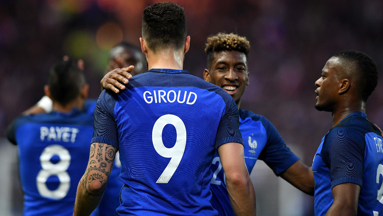 France's forward Olivier Giroud (L) celebrates with his teammates forward Kingsley Coman (C) and defender Patrice Evra (R) after scoring a goal during the International friendly football match between France and Cameroon at the Beaujoire stadium, in Nantes, western France, on May 30, 2016 as part of the French team's preparation for the upcoming Euro 2016 European football championships.  FRANCK FIFE / AFP