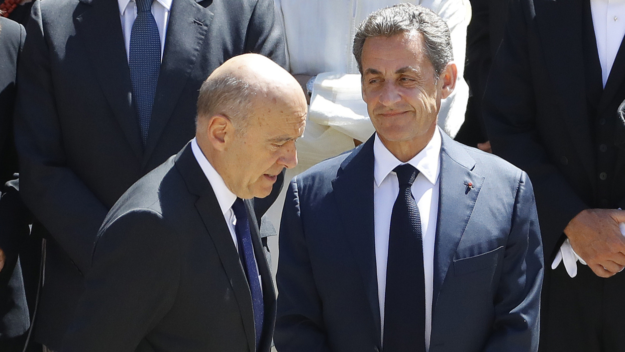 "Former French Prime Minister and presidential candidate Alain Juppé (L) walks past former French president and head of the right-wing opposition party ""Les Republicains"" (The Republicans) Nicolas Sarkozy (R) as they attend a ceremony in honour of late former French Prime Minister Michel Rocard at the Hotel des Invalides in Paris on July 7, 2016. Rocard, who died on July 2 at the aged of 85, served as prime minister for three years from mid-1988 under Francois Mitterrand, the two-term Socialist president who led the country from 1981 to 1995. PATRICK KOVARIK / AFP"