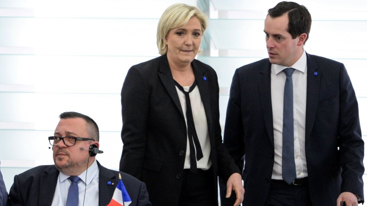 Member of the European Parliament and leader of the far-right Front National (FN) party and candidate for the presidential election, Marine Le Pen (C) arrives with General Secretary of the FN and European MP Nicolas Bay (R) for a voting session at the European Parliament in Strasbourg, eastern France, on April 5, 2017.