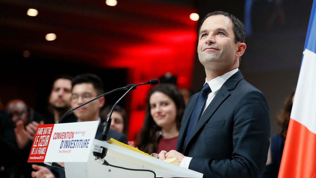 French presidential election candidate for the left-wing French Socialist (PS) party Benoit Hamon looks on as he delivers a speech during the Socialist Party (PS) leadership convention for the presidential and legislative elections on February 5, 2017 in Paris.  Thomas SAMSON / AFP