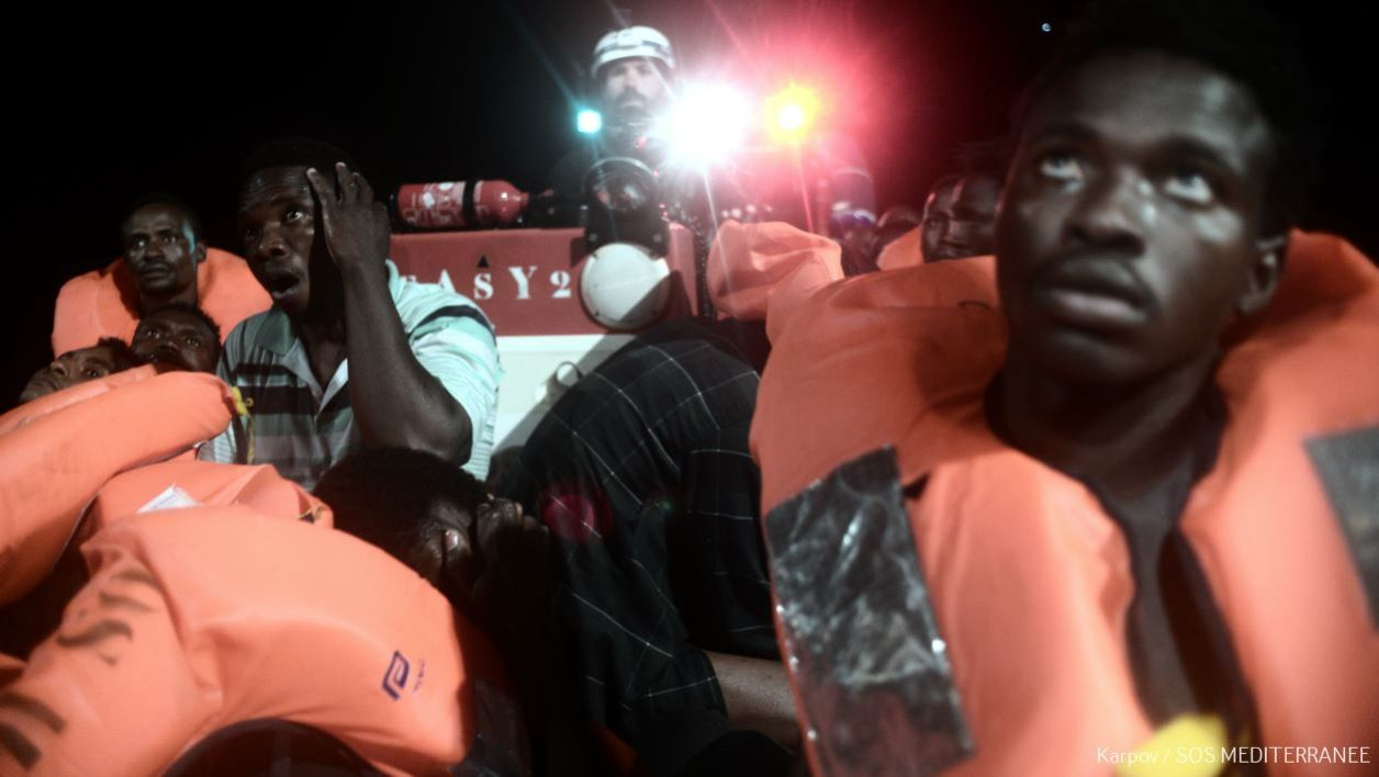 A handout picture taken in the search and rescue zone in the Mediterranean sea on June 9, 2018 and released on June 11, 2018 by SOS Mediterranee NGO shows migrants being rescued before boarding the French NGO's ship Aquarius.
