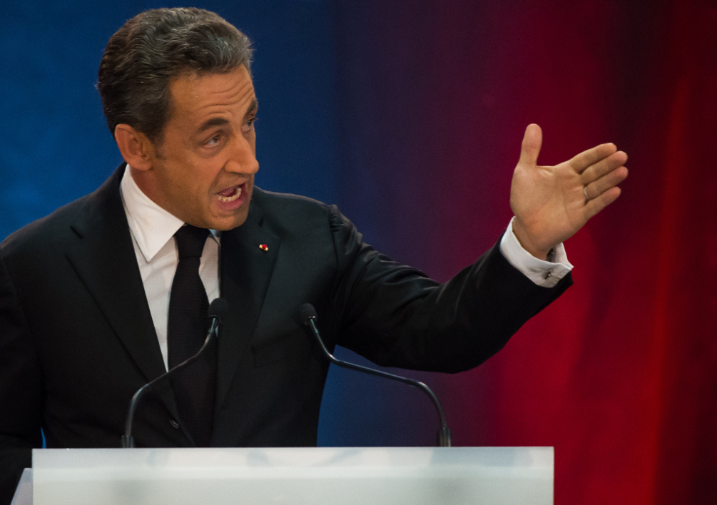 FRANCE, Lambersart : Former French President Nicolas Sarkozy (C) delivers a speech during a meeting on September 25, 2014 in the northern city of Lambersart, six days after he announced his political comeback. Sarkozy holds in Lambersart his fist meeting to take over as chief of his right-wing UMP party on November 25, 2014, a party which is fractured by dissent. Sarkozy is widely seen as aiming to reclaim for 2017 the presidency he lost to President Francois Hollande in 2012. Yesterday, a corruption and influence-peddling investigation launched in July against former French president has been suspended. AFP PHOTO PHILIPPE HUGUEN