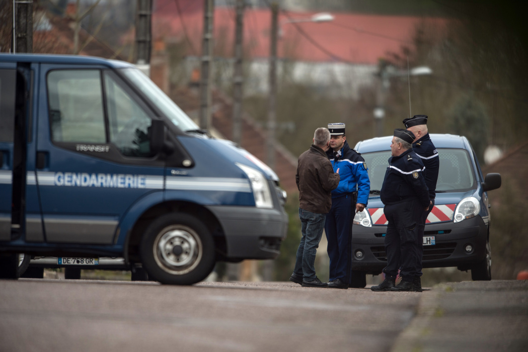 French gendarmes are parked in front of the house of Jonathann Daval, on January 29, 2018 in Gray-la-Ville, following his arrest as part of the inquiry into the murder of his wife Alexia Daval. Alexia Daval burnt body was found on October 30, 2017, three days after she was reported missing. SEBASTIEN BOZON / AFP