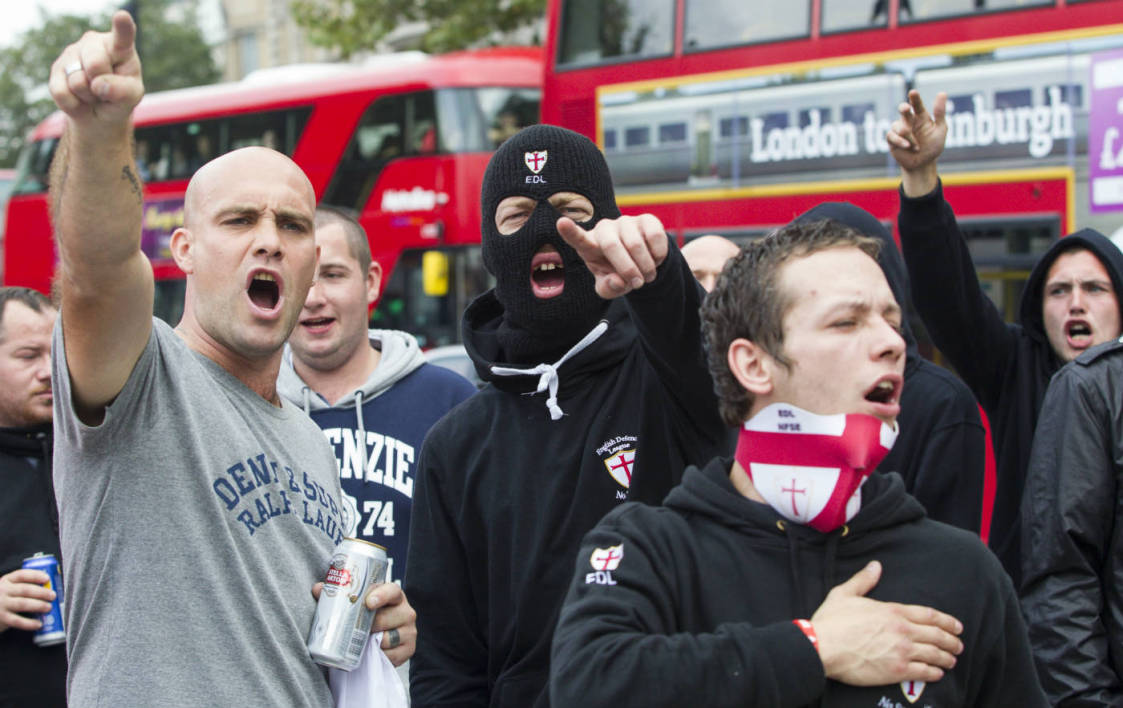 Supporters of the far-right English Defence League (EDL) take part in a march in London on September 20, 2014. Some 300 EDL supporters demonstrated in London as a counter-demonstration by Unite Against Fascism and other groups opposed to the EDL took place. AFP PHOTO/JACK TAYLOR JACK TAYLOR / AFP