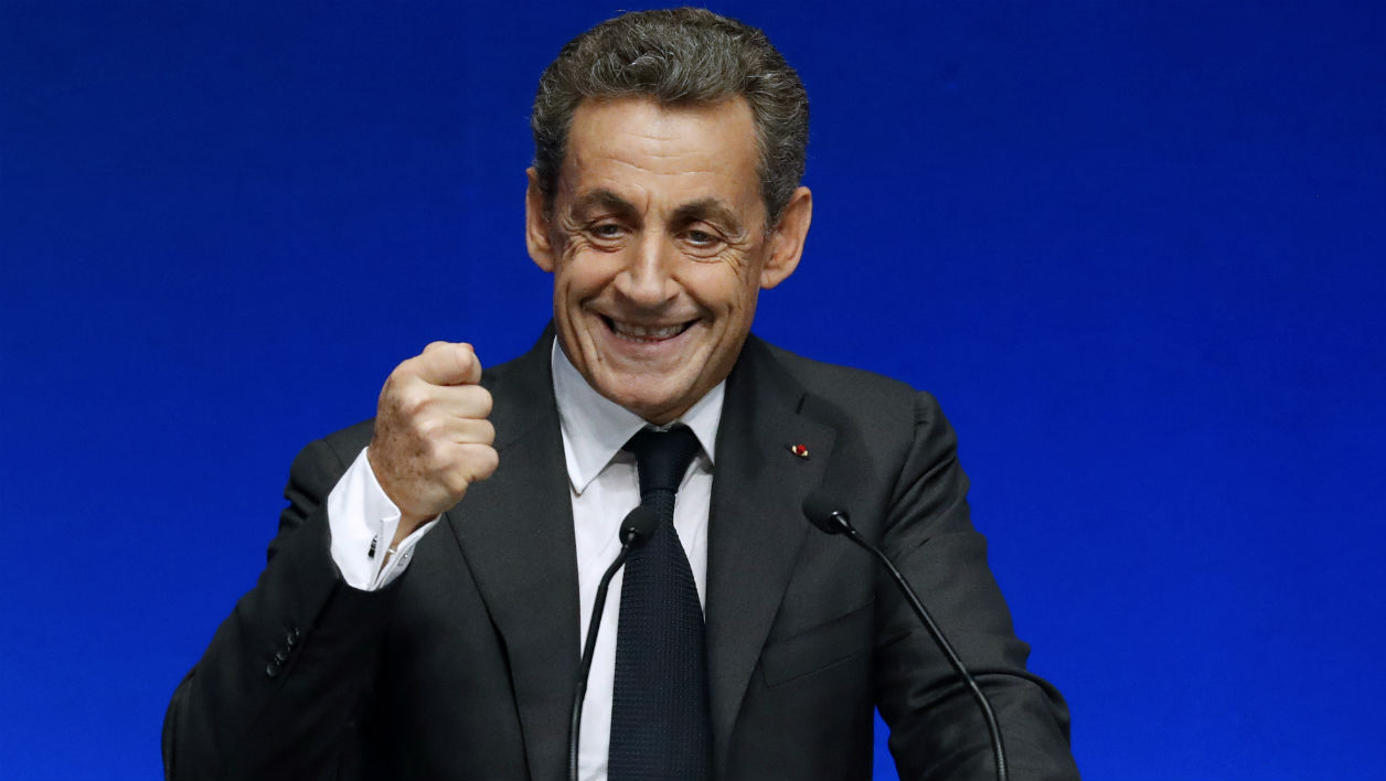 Former French President Nicolas Sarkozy gestures during the conference of the CDU Economic Council in Berlin, on June 21, 2016. The Economic Council (Wirtschaftsrat der CDU e.V.) is a German business association representing the interests of more than 11,000 small and medium sized firms, as well as larger multinational companies. John MACDOUGALL / AFP