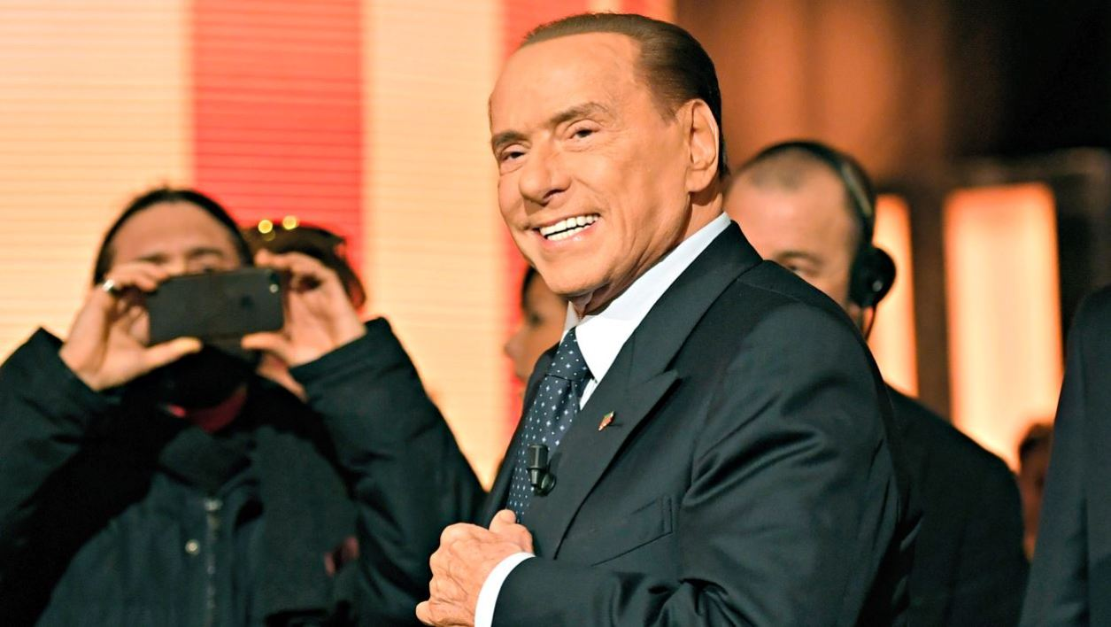 """(FILES) In this file photo taken on January 18, 2018 in Rome Italian former Prime Minister and leader of center-right party Forza Italia (Go Italy), Silvio Berlusconi arriving to attend the TV show """"Quinta Colonna"""", a programme of Italian channel Rete 4."""