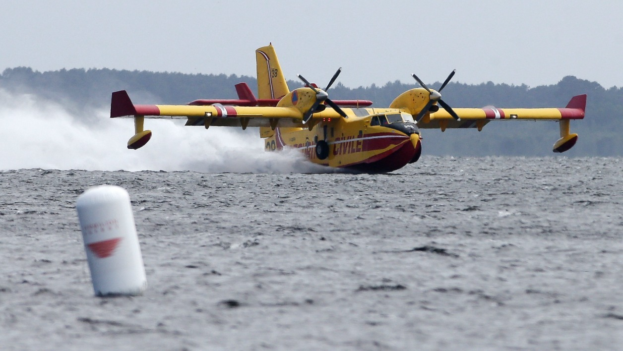 A picture taken on May 22, 2016 shows a Canadair plane during the Flying Spirit aerial meeting in Biscarrosse, southeastern France.  THIBAUD MORITZ / AFP