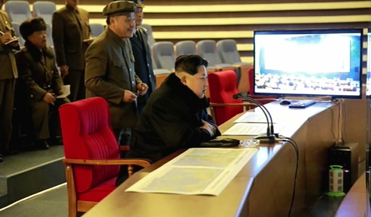 This picture taken from North Korean TV and released by South Korean news agency Yonhap on February 7, 2016 shows North Korean leader Kim Jong-Un (seated) attending the rocket launch of earth observation satellite Kwangmyong 4. North Korea said on February 7, it had successfully put a satellite into orbit, with a rocket launch widely condemned as a ballistic missile test for a weapons delivery system to strike the US mainland.