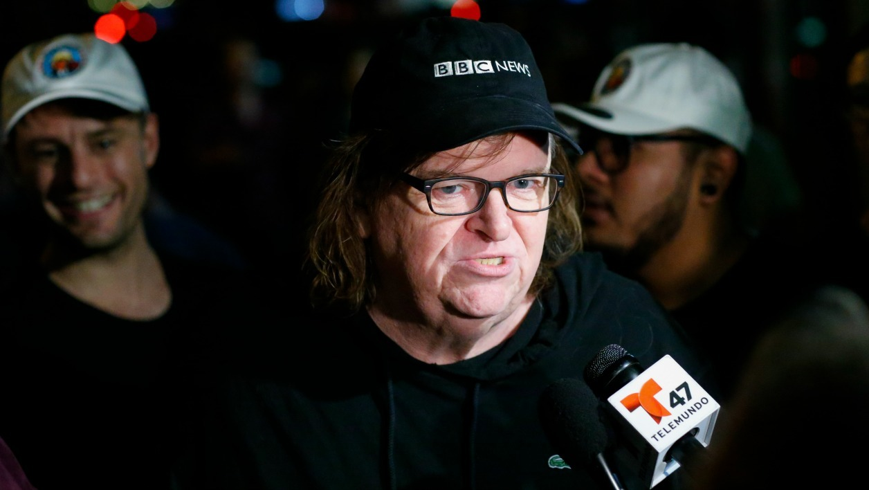 "US filmmaker Michael Moore speaks with members of the media as he arrives at the IFC Theater before the debut of a surprise documentary about Republican presidential nominee Donald Trump titled ""TrumpLand"" in New York on October 18, 2016.  KENA BETANCUR / AFP"