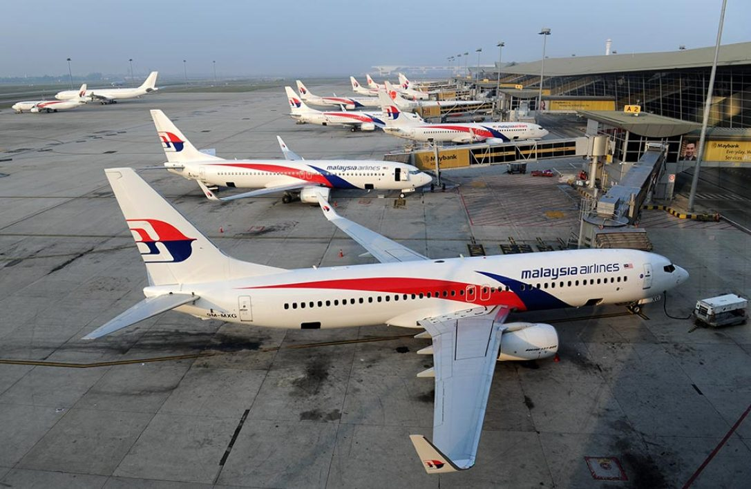 This file photo taken on March 30, 2014 shows Malaysia Airlines planes parked at the terminal at Kuala Lumpur Intenational Airport (KLIA) in Sepang. Deeply troubled Malaysia Airlines will be de-listed and taken private ahead of a major restructuring following the twin disasters of MH370 and MH17, under a proposal announced on August 8, 2014 by its majority shareholder.