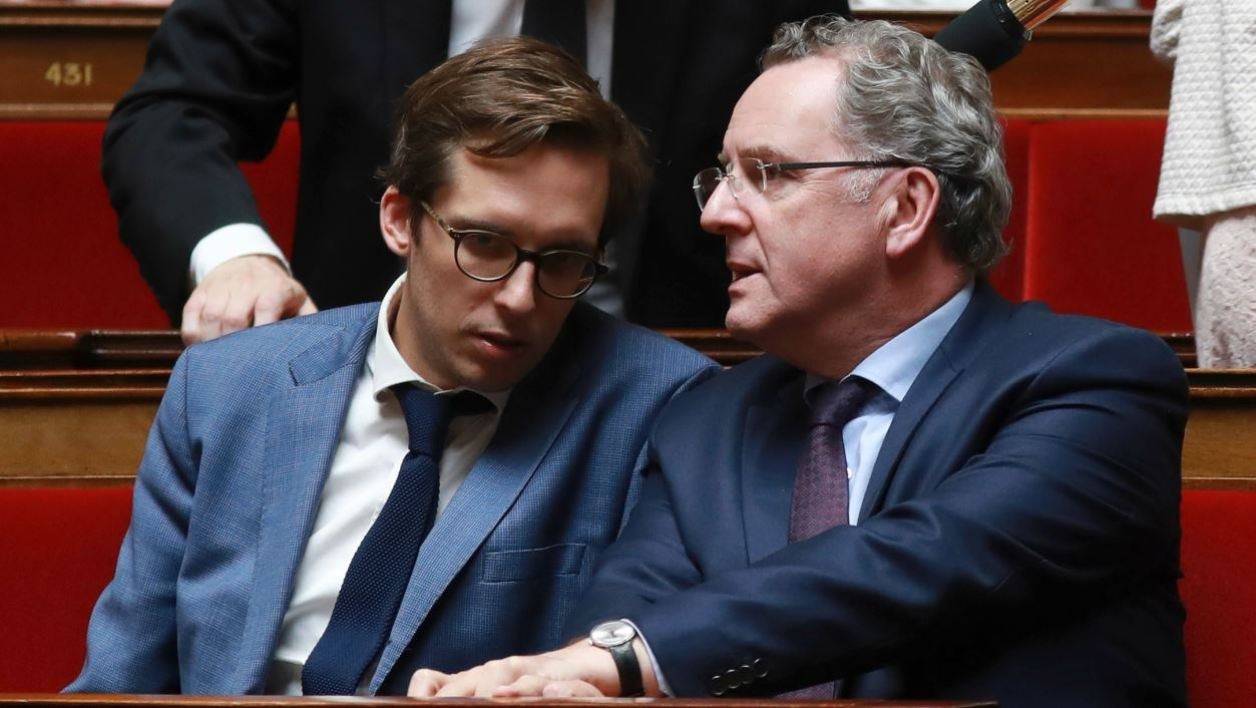 French La Republique en Marche (REM) party's group president at the French national assembly Richard Ferrand (R) speaks with REM party's PM Pacome Rupin during a session of questions to the government at the French National Assembly in Paris on August 2, 2017.  JACQUES DEMARTHON / AFP