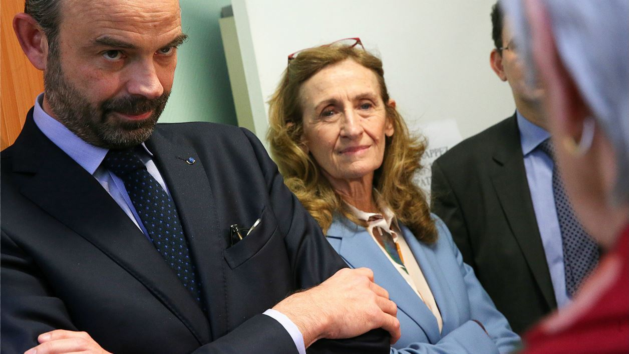 French Prime Minister Edouard Philippe (L) and French Justice Minister Nicole Belloubet meet magistrates at the Tribunal de grande instance (High court) of Reims, as they present the axes of justice reform to magistrates on March 9, 2018.  FRANCOIS NASCIMBENI / AFP