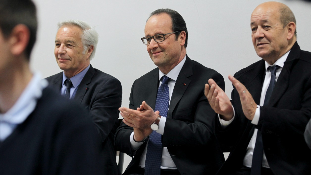 (From L) French Labour Minister Francois Rebsamen, French President Francois Hollande and French Defense Minister Jean-Yves Le Drian clap during a visit to the EPIDE (Public Establishment of Insertion of the Defense) center in Alencon, northwestern France, on April 27, 2015. AFP PHOTO / CHARLY TRIBALLEAU