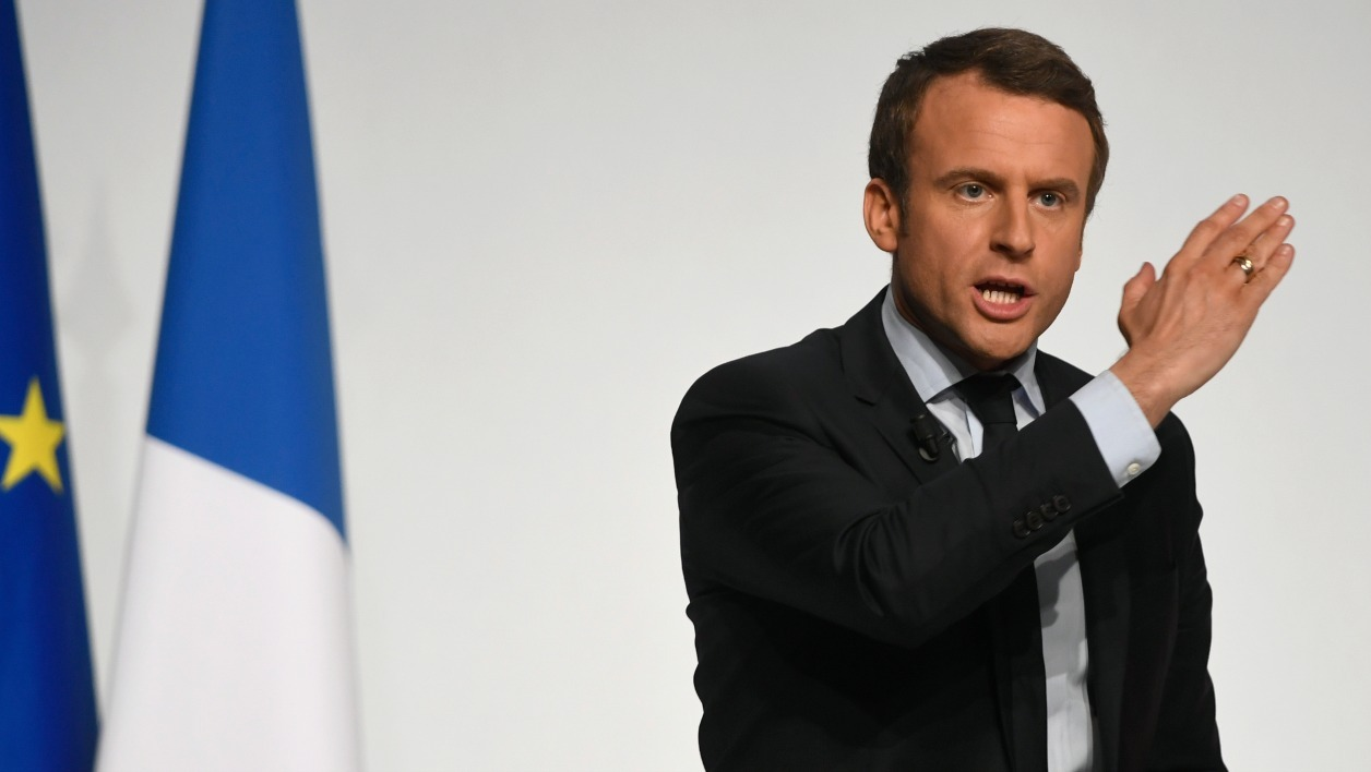 French presidential election candidate for the En Marche ! movement Emmanuel Macron gestures as he speaks to supporters at the Angerlarde hall in Chatellerault, western France on April 28, 2017. Macron's visit comes ahead of the second and final round of the presidential elections which takes place on May 7. Eric FEFERBERG / AFP