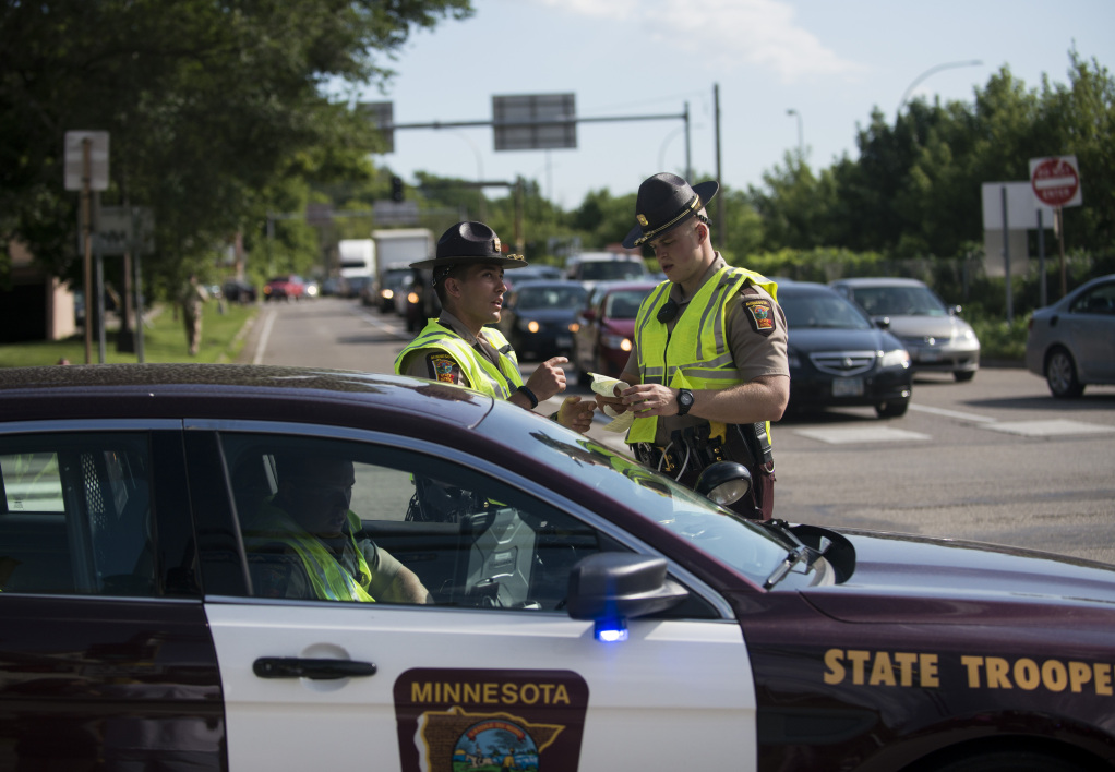 Police officers block traffic from entering highway 35W on July 13, 2016 in Minneapolis, Minnesota. Demonstrators shut down the highway to protest the killing of Philando Castile by a Falcon Heights, Minnesota police officer on July 6, 2016. STEPHEN MATUREN / GETTY IMAGES NORTH AMERICA / AFP