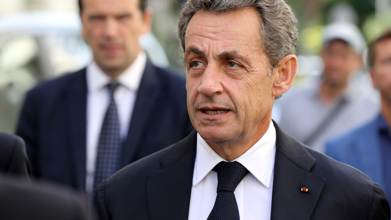 Former French president and candidate for the right-wing Les Republicains (LR) party primary ahead of the 2017 presidential election Nicolas Sarkozy walks on September 17, in a street of Nice, southeastern France, during a visit.  VALERY HACHE / AFP