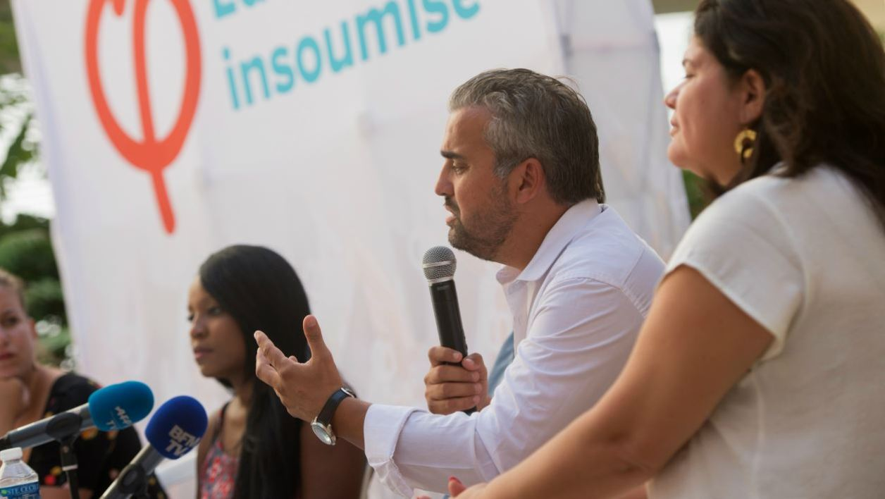 La France Insoumise (LFI) party Member of Parliament Alexis Corbiere (2R) speaks during a press conference on the second day of the LFI summer conference in Marseille, southern France on August 25, 2017. The LFI summer conference is taking place from August 24 until August 27, 2017.  BERTRAND LANGLOIS / AFP