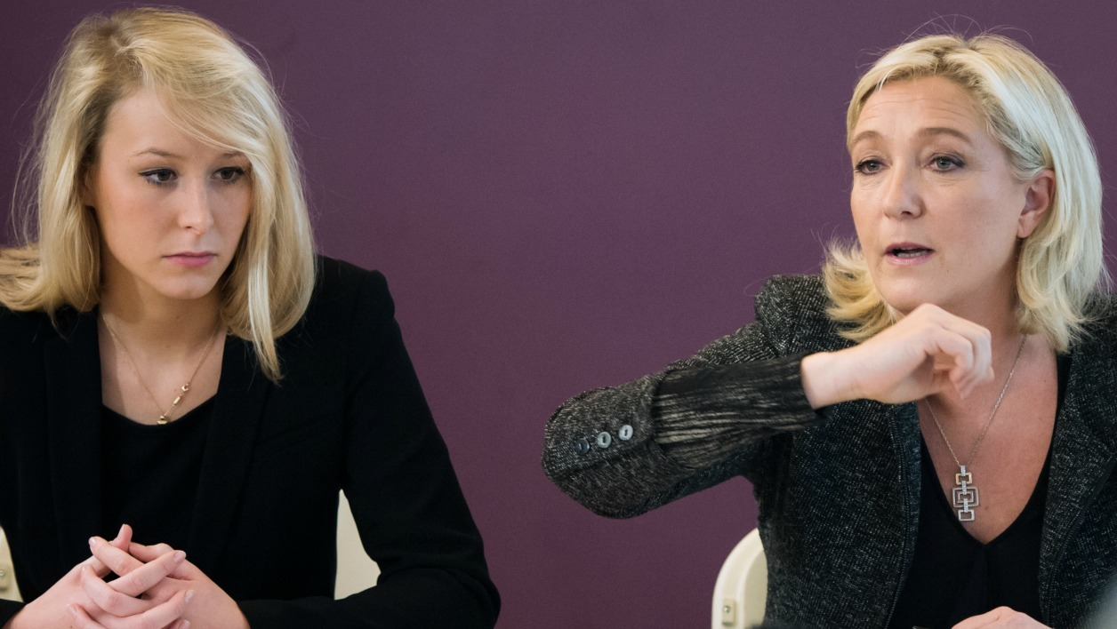 French far-right National Front (FN) party's leader Marine Le Pen (R) and FN's deputy Marion Marechal-Le Pen give a press conference on November 30, 2013 in Mazan, southern France, prior to a meeting. AFP PHOTO / BERTRAND LANGLOIS BERTRAND LANGLOIS / AFP