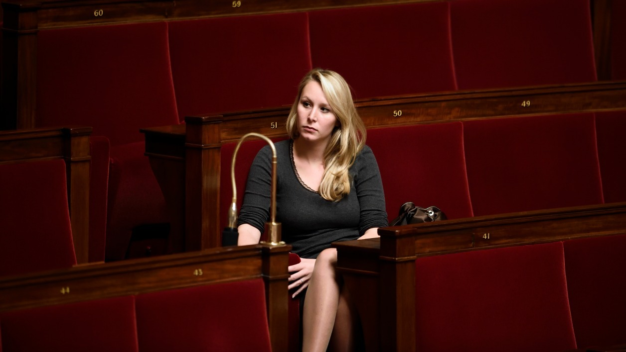 French far right Front National (FN) party member of Parliament Marion Marechal Le Pen attends a session of questions to the government on November 12, 2014 at the National Assembly in Paris. AFP PHOTO / ERIC FEFERBERG  ERIC FEFERBERG / AFP