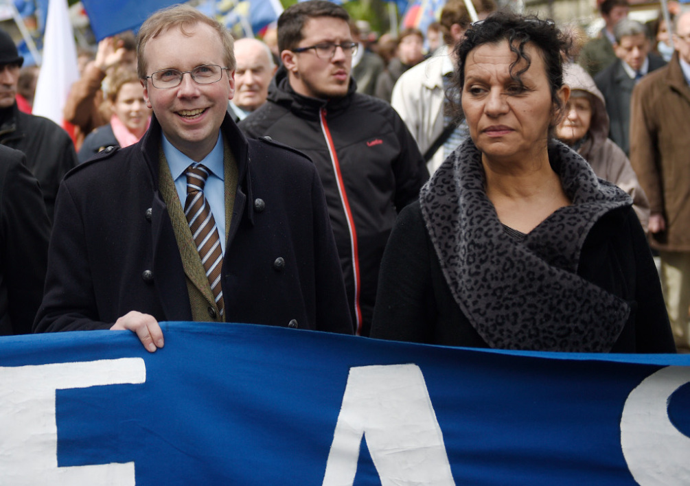 FRANCE, Paris : Leader of far-right Civitas institute Alain Escada (C) and far-right activist Farida Belghoul (R) attend a demonstration organised by the fundamentalist catholic-nationalist Civitas institute in the streets of Paris, on May 11, 2014. AFP PHOTO / MARTIN BUREAU