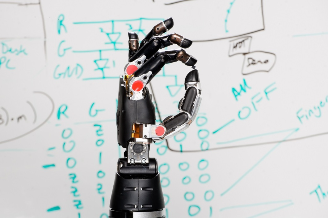 "This handout photo obtained from the US Defense Advanced Research Projects Agency(DARPA) on September 14, 2015 shows an experimental prosthetic hand that allows the user to ""feel"" sensations. After six years of development, the Revolutionizing Prosthetics program developed two anthropomorphic advanced modular prototype prosthetic arm systems, including sockets, which offer increased range of motion, dexterity and control options"