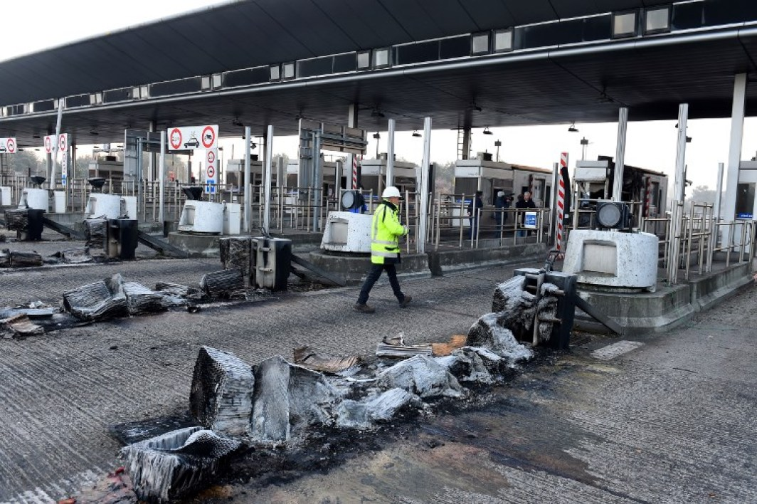 This file photo taken on November 21, 2018 in Virsac shows a damaged toll on the A10 highway, following the evacuation by riot police of a blockade by yellow vests (Gilets Jaunes) protesters, on the fifth day of a nationwide movement against the increase in fuel and oil prices. Five people were arrested on early December 4, 2018, in connection with the damage of a toll station two weeks ago on the A10 motorway in Virsac (Gironde), according to the prosecutor's office. NICOLAS TUCAT / AFP