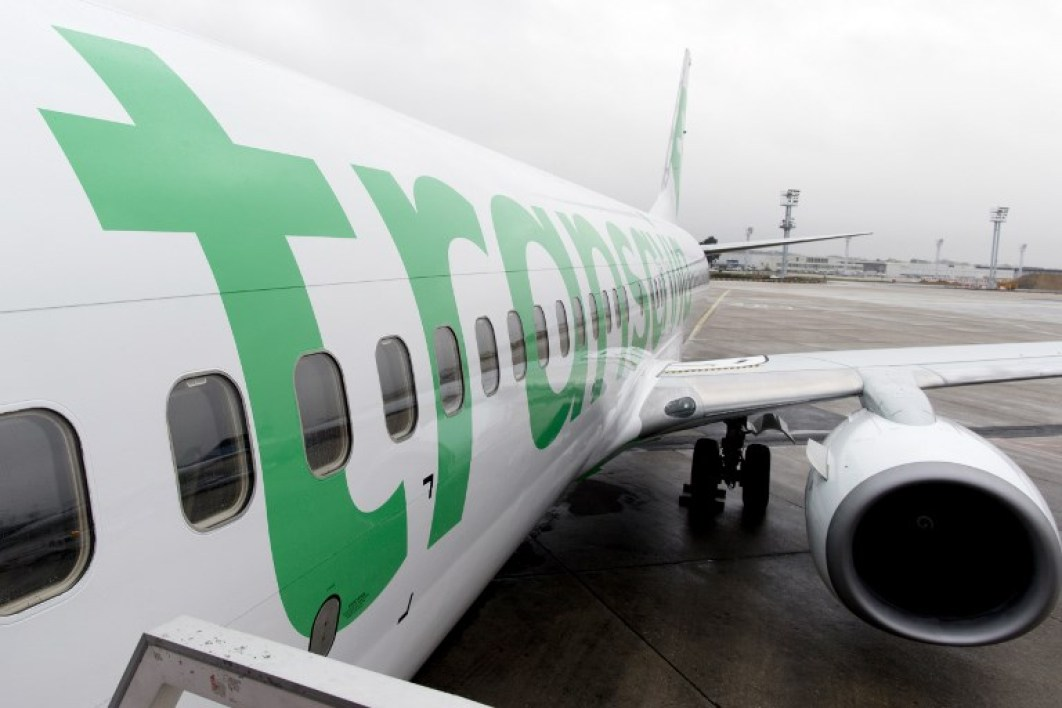 A Boeing 737-800 aircraft of low-cost airliner Transavia, a subsidiary of French commercial jet liner Air France features on January 26, 2015 the new color and logo of the company at Paris-Orly airport in Orly. AFP PHOTO / KENZO TRIBOUILLARD KENZO TRIBOUILLARD / AFP