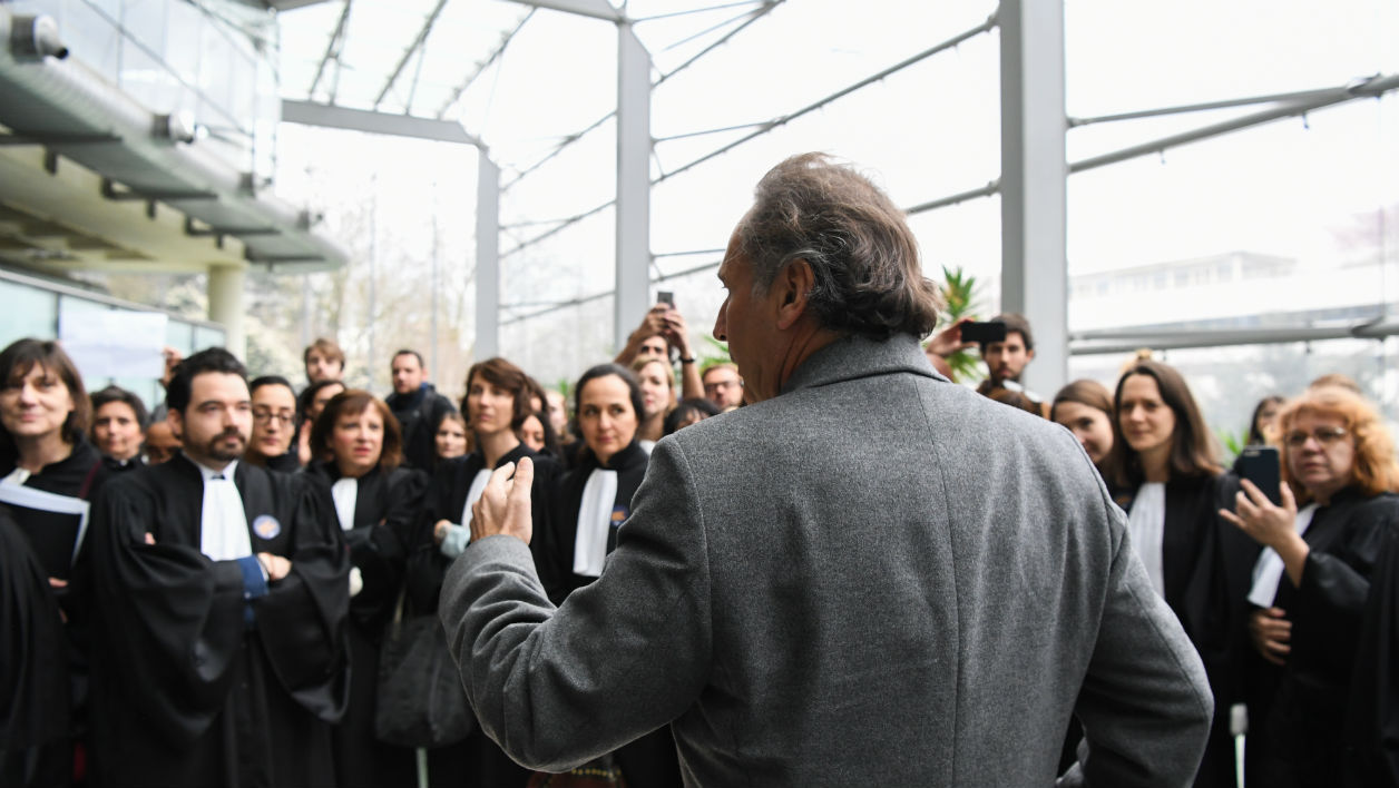 Lawyer for Laura Smet, daughter of late French singer Johnny Hallyday, Pierre-Olivier Sur (Front) reacts as he arrives at the Nanterre Regional courthouse, during a demonstration of lawyers and magistrates as part of a nation wide day of protest against a government draft law on Justice, in Nanterre, near Paris, on March 30, 2018.