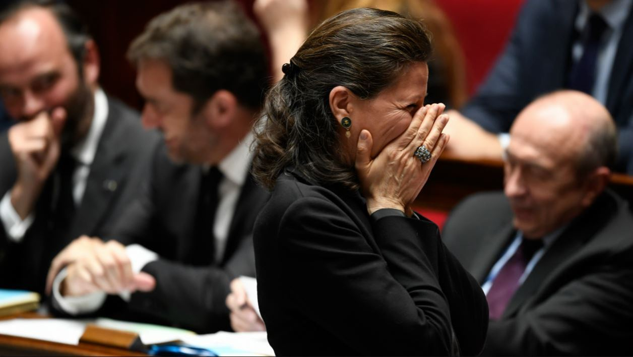 French Minister for Solidarity and Health Agnes Buzyn laughs during a session of questions to the government at the French National Assembly in Paris on March 28, 2018.  BERTRAND GUAY / AFP