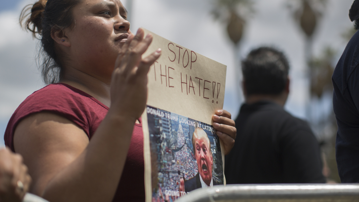 EAST LOS ANGELES, CA - MAY 23: Maria Antonio holds an anti-Donald Trump sign at a campaign rally for Democratic presidential candidate Sen. Bernie Sanders at Lincoln Park on May 23, 2016 in East Los Angeles, California. Sanders is campaigning ahead of the June 7 California primary. David McNew/Getty Images/AFP