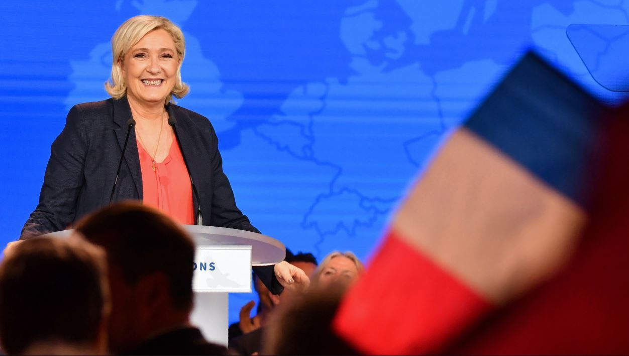 "Leader of the French far-right Front National (FN) party Marine Le Pen speaks during a rally of the ""Nations Movement for a Europe of Nations and Freedom"" (MENL) in Nice on May 1, 2018.  YANN COATSALIOU / AFP"