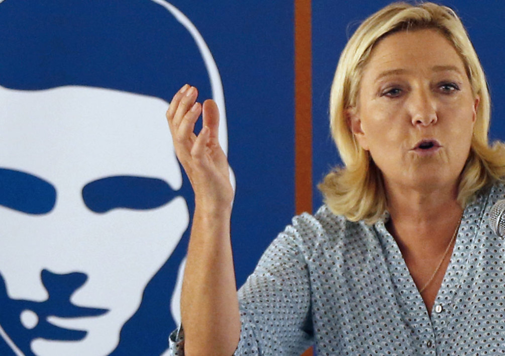 FRANCE, Fréjus : France's far-right National Front (FN) leader Marine Le Pen delivers a speech during the party's summer youth congress in Frejus on September 7, 2014. AFP PHOTO / VALERY HACHE