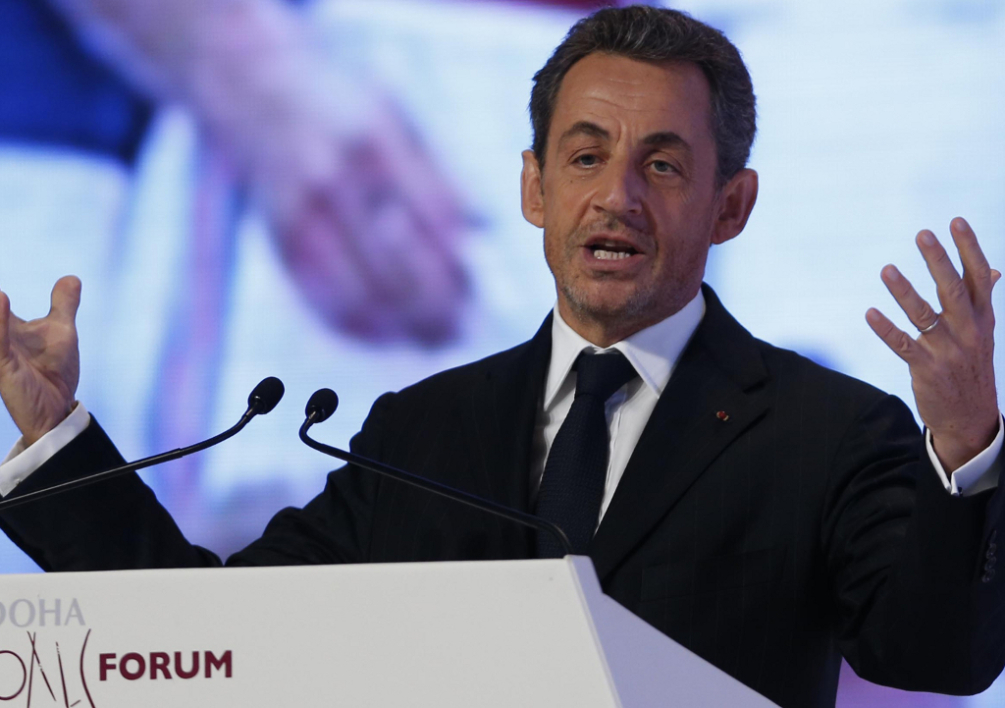 "QATAR, Doha : Former French President Nicolas Sarkozy speaks during the official opening ceremony of the Gathering Of All Leaders In Sport (GOALS) forum in Doha, on December 11, 2012. Sarkozy, 57-years-old, said during his first public appearance since being beaten by Francois Hollande in the race for the Elysee, that an ""absolutely decisive"" change was taking place in Qatar, which is rapidly becoming a powerhouse in world sport and is due to host the football World Cup in 2022. AFP PHOTO /KARIM JAAFAR / AL-WATAN DOHA == QATAR OUT"