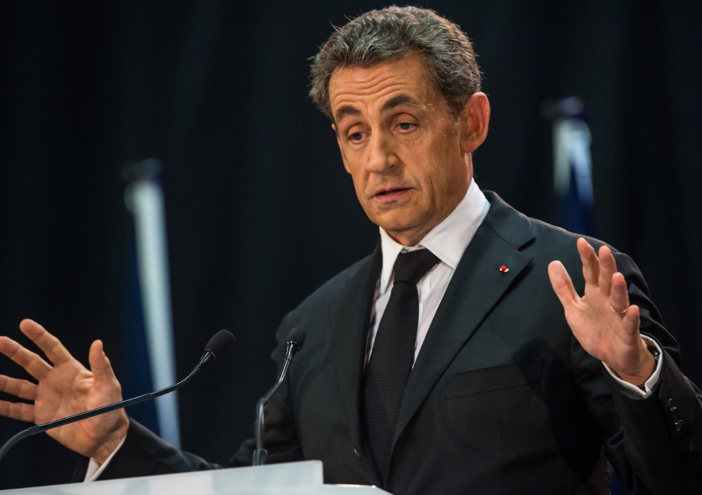 FRANCE, Lambersart : Former French President Nicolas Sarkozy delivers a speech during a meeting on September 25, 2014 in the northern city of Lambersart, six days after he announced his political comeback. Sarkozy held his first meeting in Lambersart, hoping again to take over in two months time as chief of his UMP party which is fractured by dissent. A corruption and influence-peddling investigation launched in July against the former French president was suspended after he announced his political comeback. AFP PHOTO PHILIPPE HUGUEN