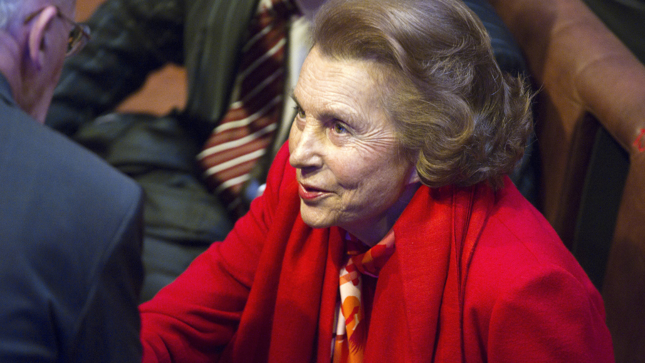 France's richest woman, L'Oreal heiress Liliane Bettencourt is greeted prior to an award ceremony of the Bettencourt Schueller Foundation, on October 18, 2010 at the Quai Branly museum in Paris. The foundation, created in Bettencourt father's memory (L'Oreal founder Eugene Schueller), helps initiate support and develop projects within the medical, cultural, and humanitarian areas. AFP PHOTO FRED DUFOUR FRED DUFOUR / AFP