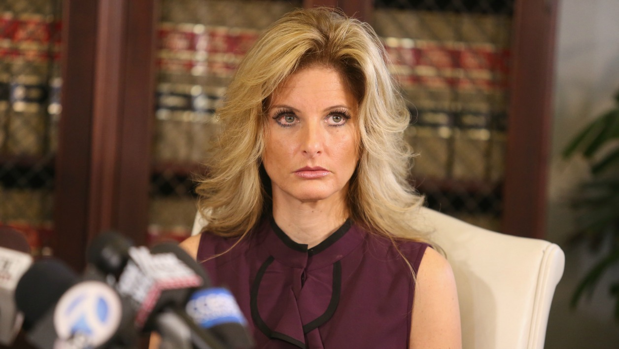 "LOS ANGELES, CA - OCTOBER 14: Summer Zervos, a former candidate on ""The Apprentice"" season five, who is accusing Donald Trump of inappropriate sexual conduct, speaks to the press with her attorney Gloria Allred October"