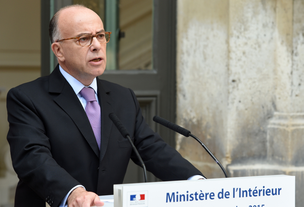 French Interior minister Bernard Cazeneuve delivers a speech on measures France has decided to take to welcome more asylum-seekers, on September 7, 2015 at the Interior ministry in Paris. As European leaders stepped up efforts to tackle the historic migrants crisis, France said it would take 24,000 more asylum-seekers under a European plan to relocate 120,000 refugees from hard-hit frontline countries.