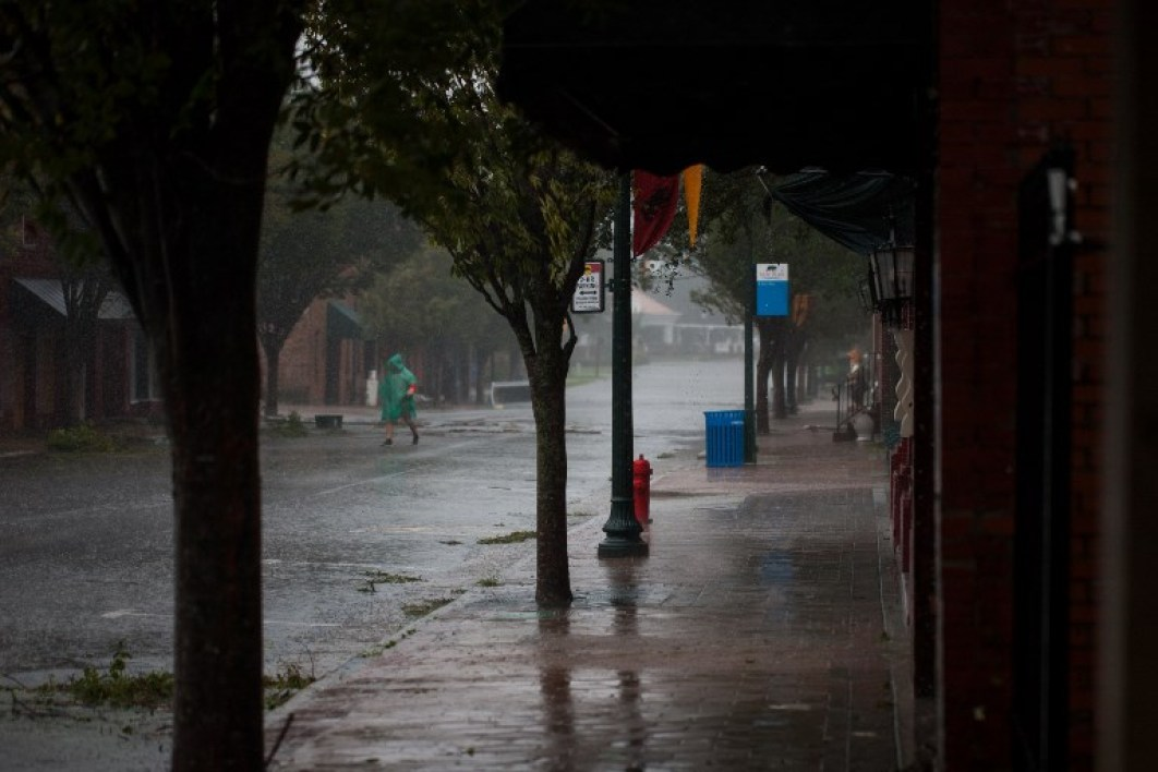 Residents walk in the rain in New Bern, North Carolina, on September 14, 2018 during Hurricane Florence.  Logan Cyrus / AFP