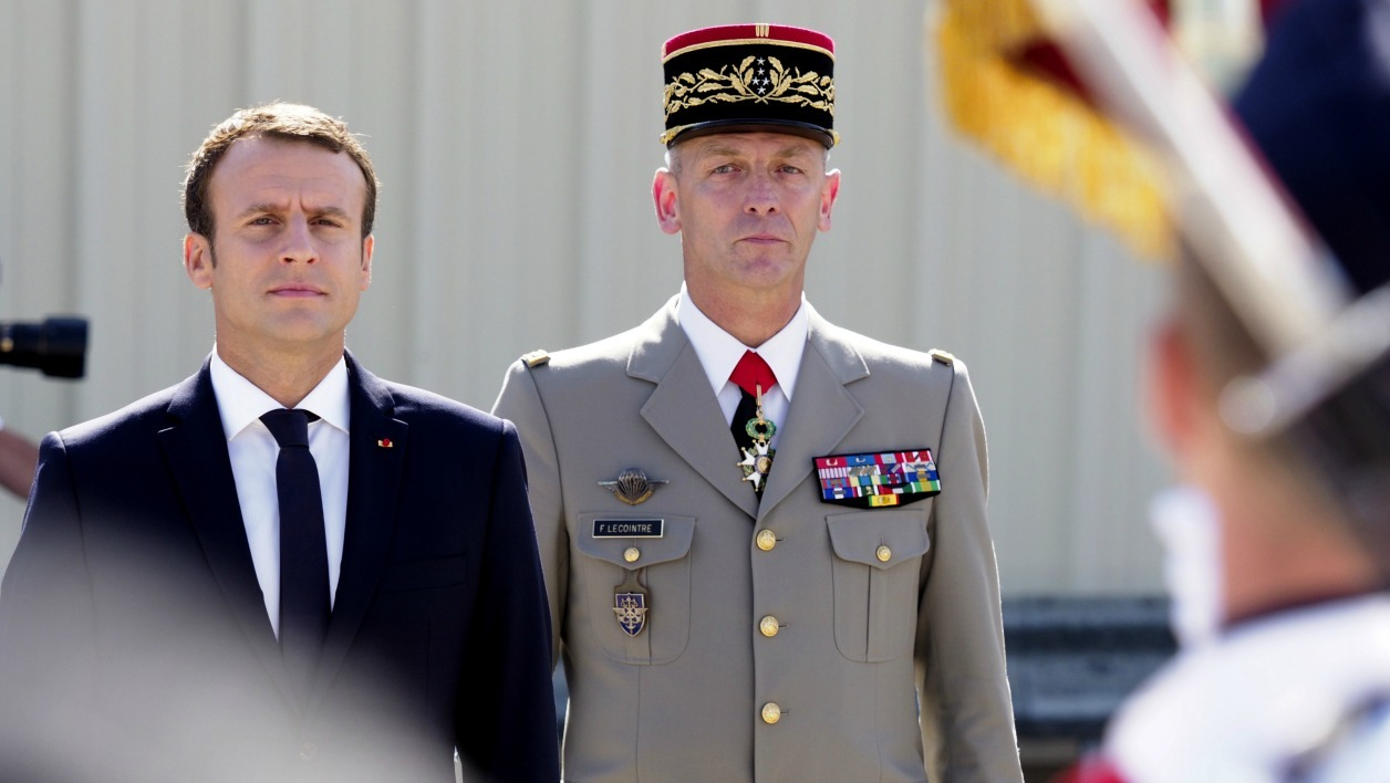 French President Emmanuel Macron (L) and new French chief of military staff General Francois Lecointre (R) review an honour guard at the BA 125 French Air Force base in Istres on July 20, 2017. France's top military chief resigned on July 19 after a war of words with Macron over budget cuts that tested the new president's authority. Lecointre, a 55-year-old hero of the Balkans wars, was named as a replacement. Arnold JEROCKI / POOL / AFP