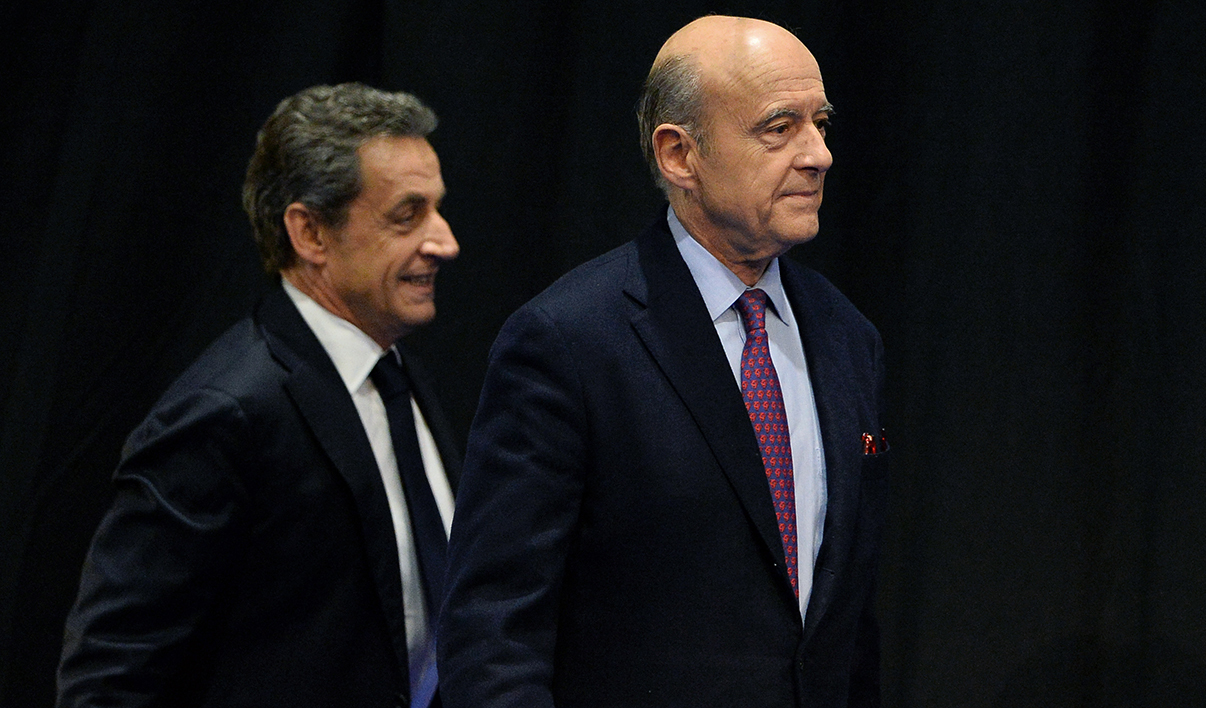 Former French President and French right-wing Les Republicains (LR) party President Nicolas Sarkozy (L) arrives with mayor of Bordeaux Alain Juppe for the campaign meeting of Virginie Calmels, LR candidate in the regional elections in the Aquitaine-Limousin-Poitou-Charentes region, in Limoges on October 14, 2015