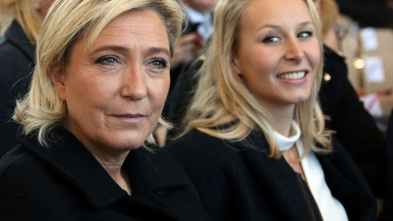 French far-right National Front party's leader Marine Le Pen (L) and FN Parliament member Marion Marechal-Le Pen attend on October 15, 2016 in Nice, southeastern France a national tribute to the victims of the July 14 terror attack in which a truck ploughed into crowds celebrating Bastille Day.