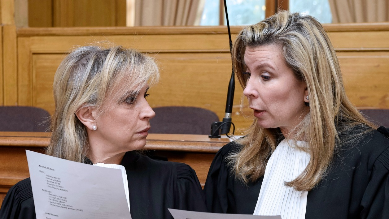 Lawyers Janine Bonaggiunta (L) and Nathalie Tomasini (R) get ready before the starting of the trial of their client Sylvie Leclerc, charged in the murder of her husband, on March 21, 2016 at the criminal court of Nancy, eastern France. An evening of May 2012, she shot her husband in the thorax with a gun, while he was sleeping in their bed in Jarville-la-Malgrange.