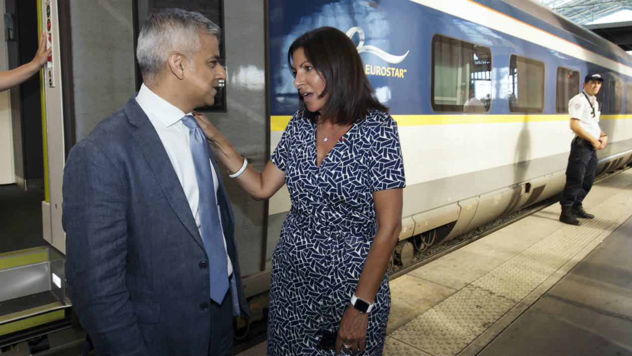Mayor of Paris Anne Hidalgo (R) greets her counterpart from London, Sadiq Khan after he arrived by Eurostar at the Gare du Nord railway station in Paris on August 25 , 2016.