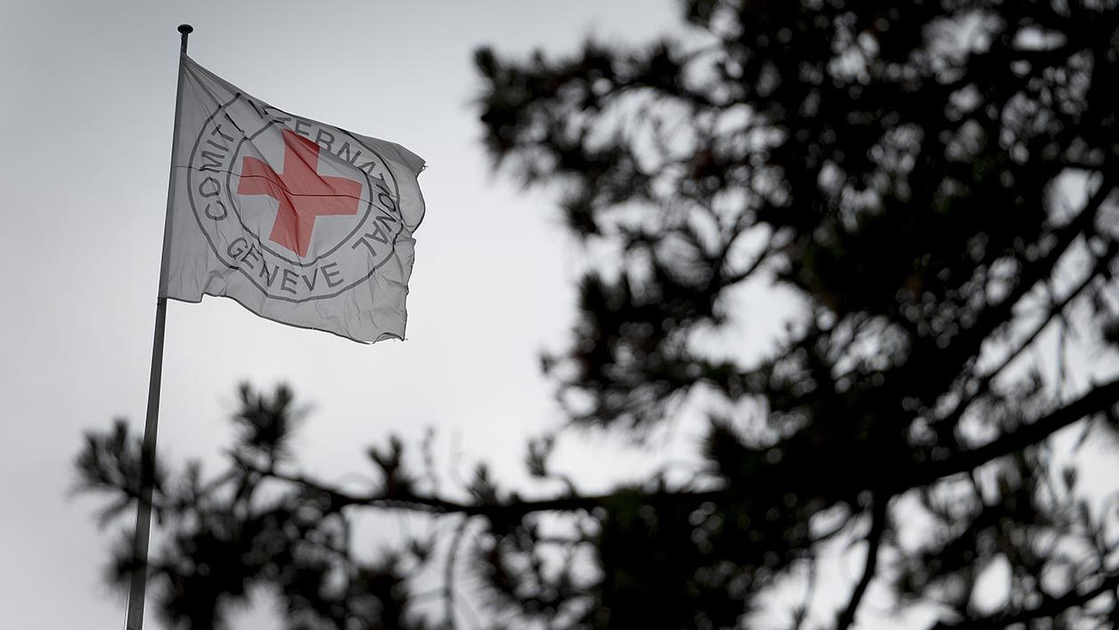 "A flag floats at the top of the International Committee of the Red Cross (ICRC) headquarters in Geneva, on June 4, 2014. ICRC said today that one of its aid workers, a Swiss citizen, had been killed in the Libyan city of Sirte. ""He was attacked by gunmen as he left a meeting with two colleagues. He died in Sirte's hospital. His colleagues are unhurt but in shock,"" ICRC spokesman Wolde Saugeron told AFP. AFP PHOTO / FABRICE COFFRINI"