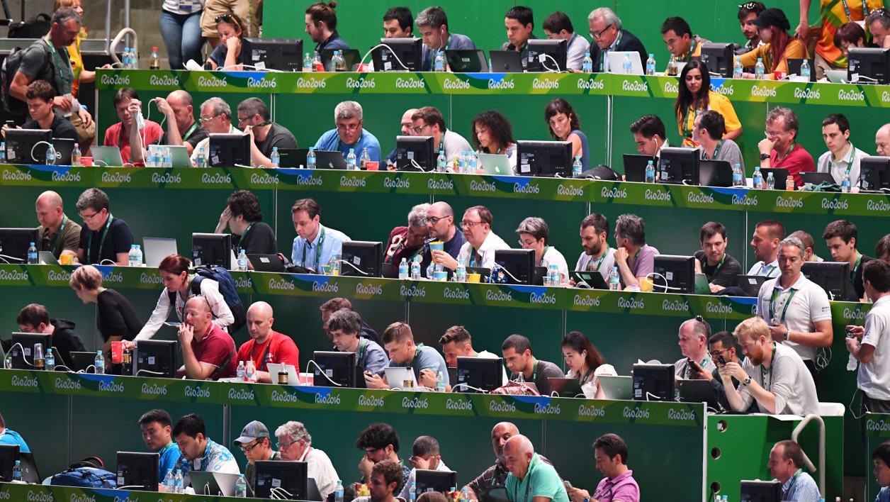 Journalists work ahead of the opening ceremony of the Rio 2016 Olympic Games at the Maracana stadium in Rio de Janeiro on August 5, 2016. GABRIEL BOUYS / AFP