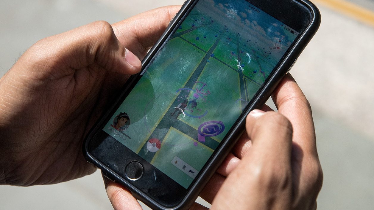 NEW YORK, NY - JULY 11: Sameer Uddin plays Pokemon Go on his smartphone outside of Nintendo's flagship store, July 11, 2016 in New York City. The success of Nintendo's new smartphone game, Pokemon Go, has sent shares of Nintendo soaring. Drew Angerer/Getty Images/AFP  Drew Angerer / GETTY IMAGES NORTH AMERICA / AFP