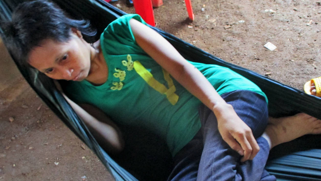 This handout photo taken on July 30, 2016 released by the Cambodian Human Rights and Development Association (ADHOC)on August 1, 2016 shows jungle girl Rochom P'ngieng laying on a hammock at a village in Rattanak Kiri province. A Vietnamese man claims he is the real father of a woman whose plight gripped Cambodia after she apparently spent 18-years living in the jungle, her adoptive family said on August 1, 2016.