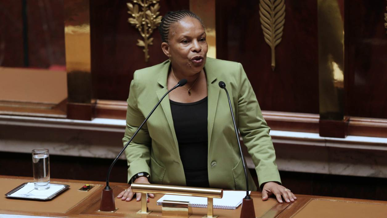 Christiane Taubira speaks during the first day of the debate to legalize same-sex marriage on January 29, 2013 at the National Assembly in Paris. The French National Assembly is due to begin a marathon debate on legalising same-sex marriage after months of public protests and counter-protests. AFP PHOTO/JACQUES DEMARTHON