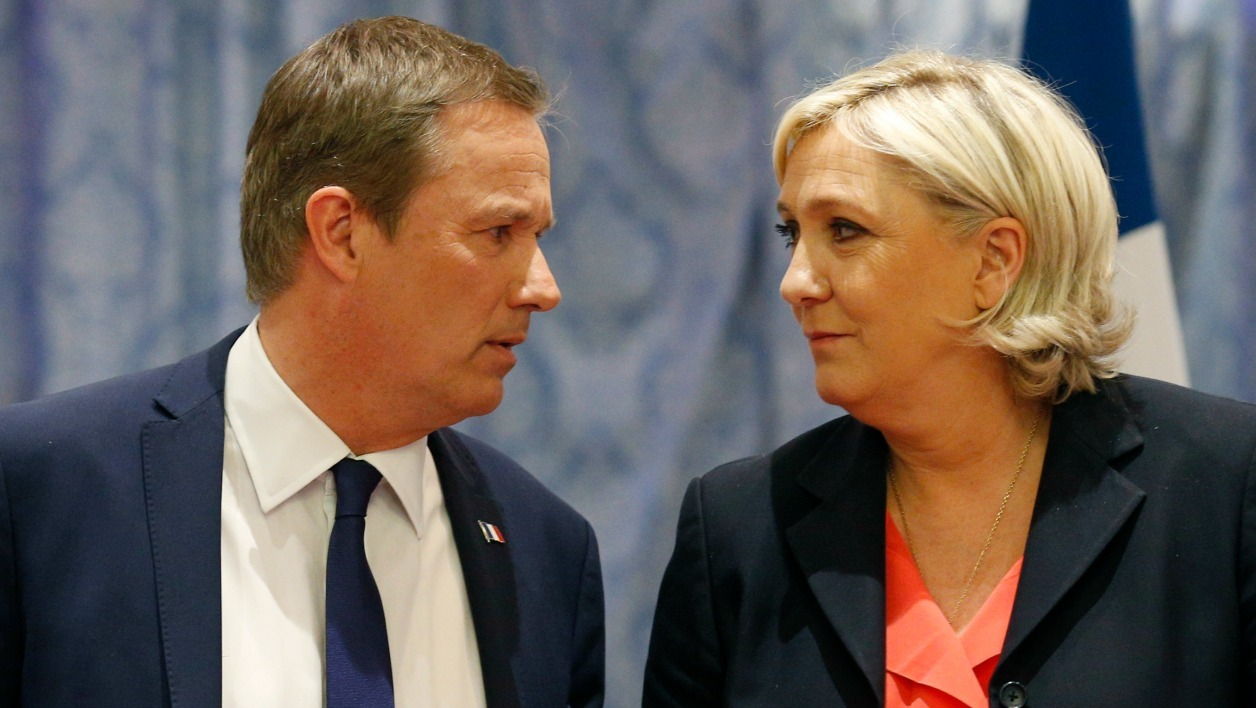 "Former French presidential election candidate for the right-wing Debout la France (DLF) party Nicolas Dupont-Aignan (L) and French presidential election candidate for the far-right Front National (FN) party Marine Le Pen, look at each other upon their arrival for a joint statement at FN headquarters in Paris, on April 29, 2017. Dupont-Aignan, who arrived on the sixth position with 4.7% of the votes during the first round of the presidential election, announced on April 28, 2017 that ""he endorses"" Marine Le Pen for the second round of the election. The candidate of the FN declared that she will appoint Dupont-Aignan as Prime minister if she will be elected. GEOFFROY VAN DER HASSELT / AFP"